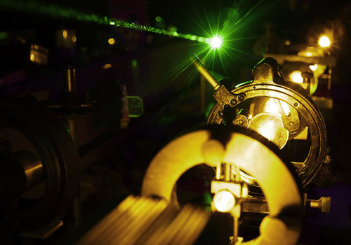 high power laser facilities - bright yellow laser light